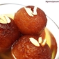 Home-made Gulab Jamuns( Golden fried milk balls in flavored sugar syrup)