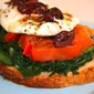 The tartine for busy days – Tartine with sauté dandelions, grilled tomatoes, poached egg, olive vinaigrette