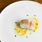 Pave of cod with spices, sauce and juice passion brandade