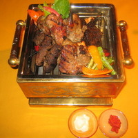 mixed grilled meats with oriental rice &vegetables