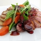 Pan-Seared Duck Breasts with Pomegranate Jus, Persimmon Salad, and Crispy Thyme Potatoes
