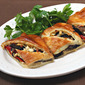 Goat cheese (Recipe: grilled vegetable and goat cheese puff pastry tart with zucchini, mushrooms, peppers and onions)
