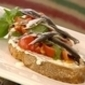 Bruschetta of Fromage Blanc with tomatoes, basil & anchovies