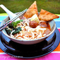Street Food Tom Yum Noodle Soup With Crispy Wontons