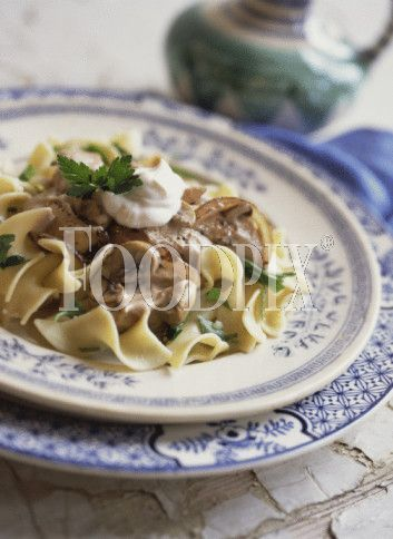 Beef stroganoff over buttered noodles Recipe by - CookEatShare