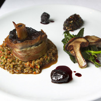 Venison Osso Bucco with Farroto and Dried Plum Salsa Seca