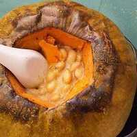 Pumpkin stuffed with beans and smoked fish