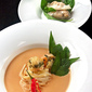 Fragrant Almond Laksa with noodles, fresh herbs, Oriental garden crispy prawns and southern Italian Har Gao dumplings