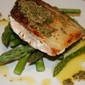 Pan-roasted salmon with anchovy and rosemary sauce.