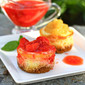 Vanilla Bean Cheesecake with Strawberry Grand Marnier Sauce OR Jamaican Pineapple Rum Sauce