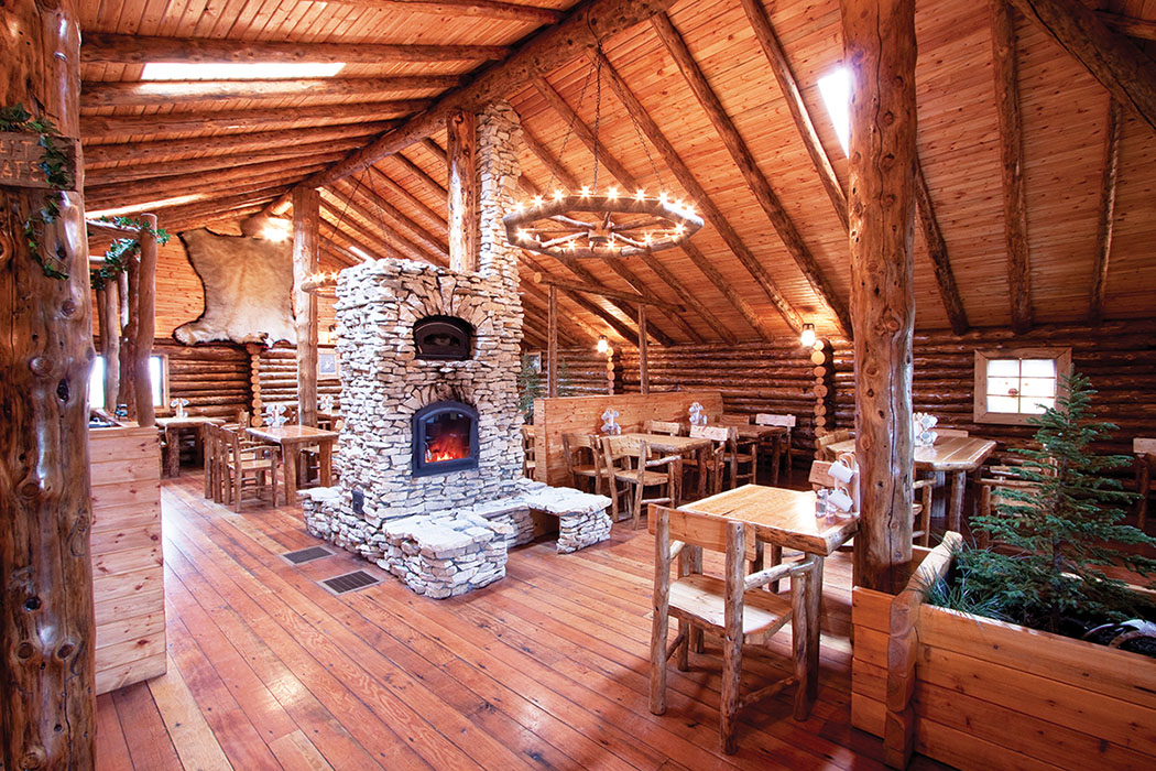 Relax in the cozy atmosphere of Churchill's Lazy Bear Lodge, with wood cabins and roaring fireplaces.
