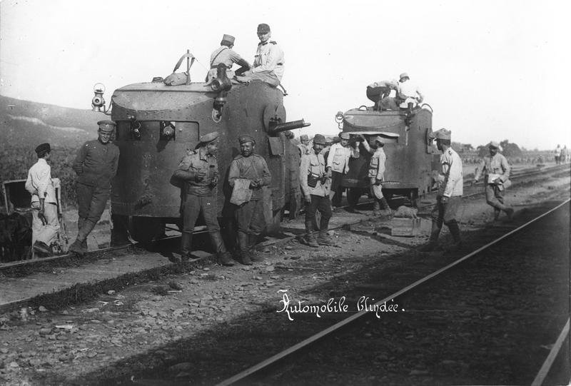 Armored-car-and-rail-group-of-soldiers.jpg
