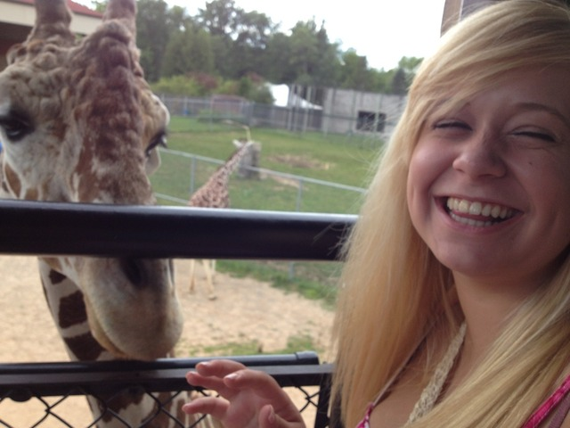 My girlfriend loves giraffes and I brought her to the local zoo to feed one, her reaction makes me so happy.