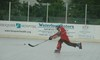 Hockey_spring_2013_-_slapshot_cropped
