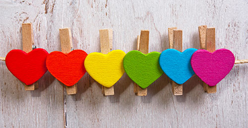 Photo: rainbow colored hearts in a row