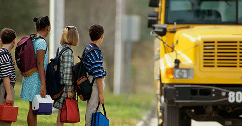 Photo of students preparing to ride the bus.