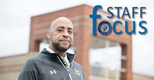 Photo of Anthony Bell in front of homewood with Staff Focus logo in background