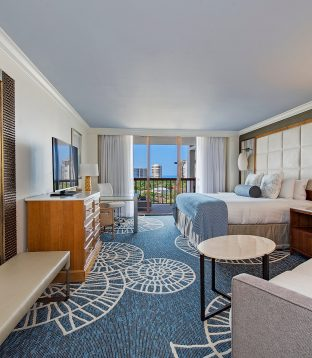 Completely transformed guestrooms featuring a beach-inspired palette.