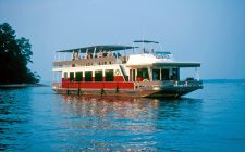 Cigar cruise boat on water