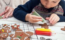 Child decorating gingerbread cookie