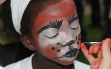 a child getting face painting.