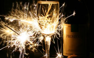 Sparklers next to wine glass