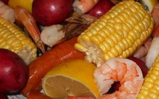 Plate of Country Boil with corn,shrimp, potato, sausage
