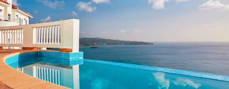 outdoor pool and view of ocean at resort in St Lucia