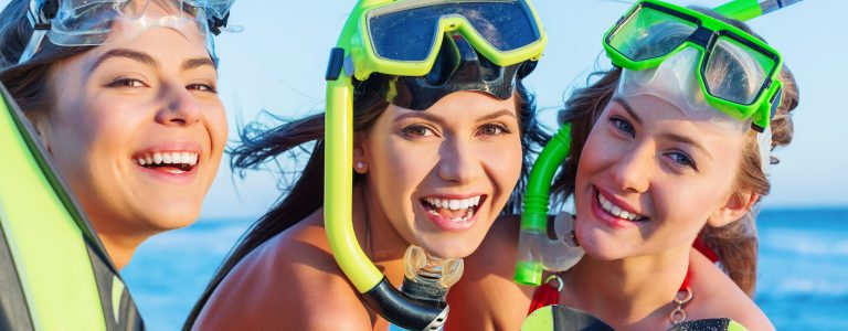 three girls with snorkel gear on