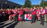 Johnson, Knaus don red vests and surprise Lowe's employees