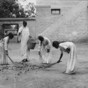 sweeping leaves 1910 India