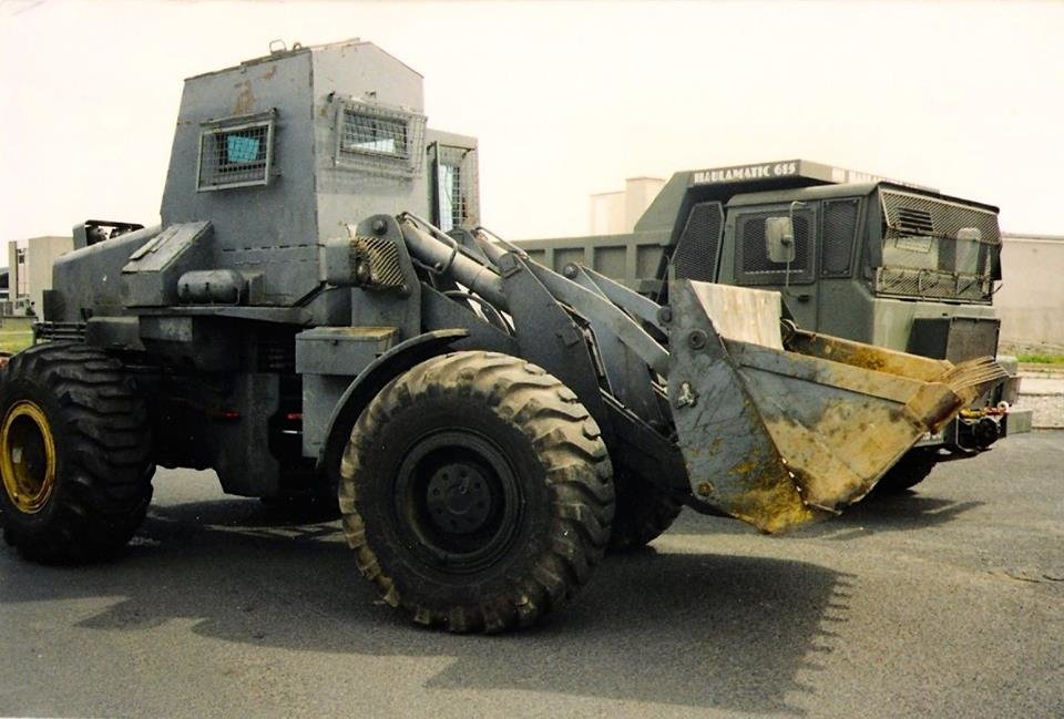 Armoured Allis Chalmers 645 with Haulamatic Dumptruck.jpg