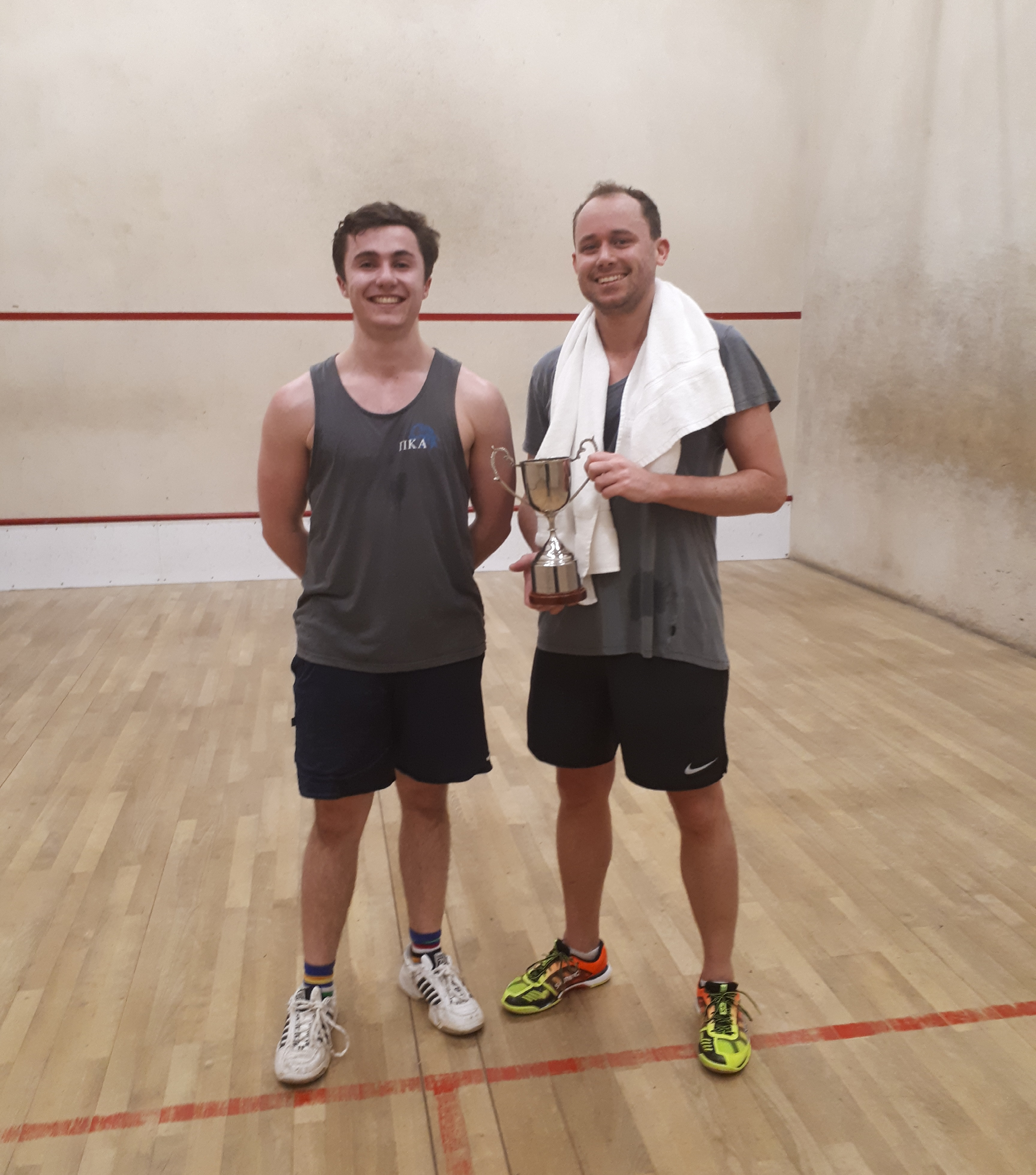 Squash court final players