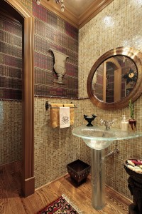 Half bath with all-glass basin and walls in wood and tile with wood floor