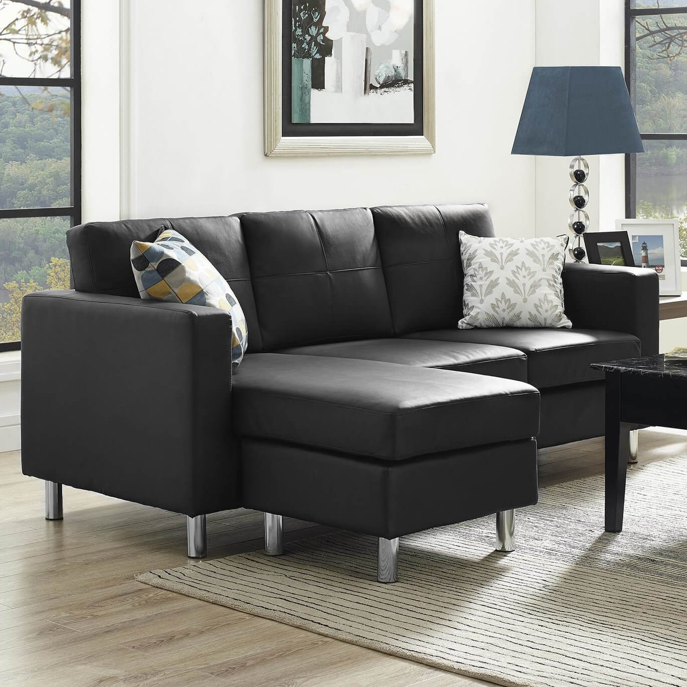 A lovely black sectional with a reversible chaise. The legs are aluminum and the piece is upholstered in a tailored faux leather in black ... : modern sectional chaise - Sectionals, Sofas & Couches