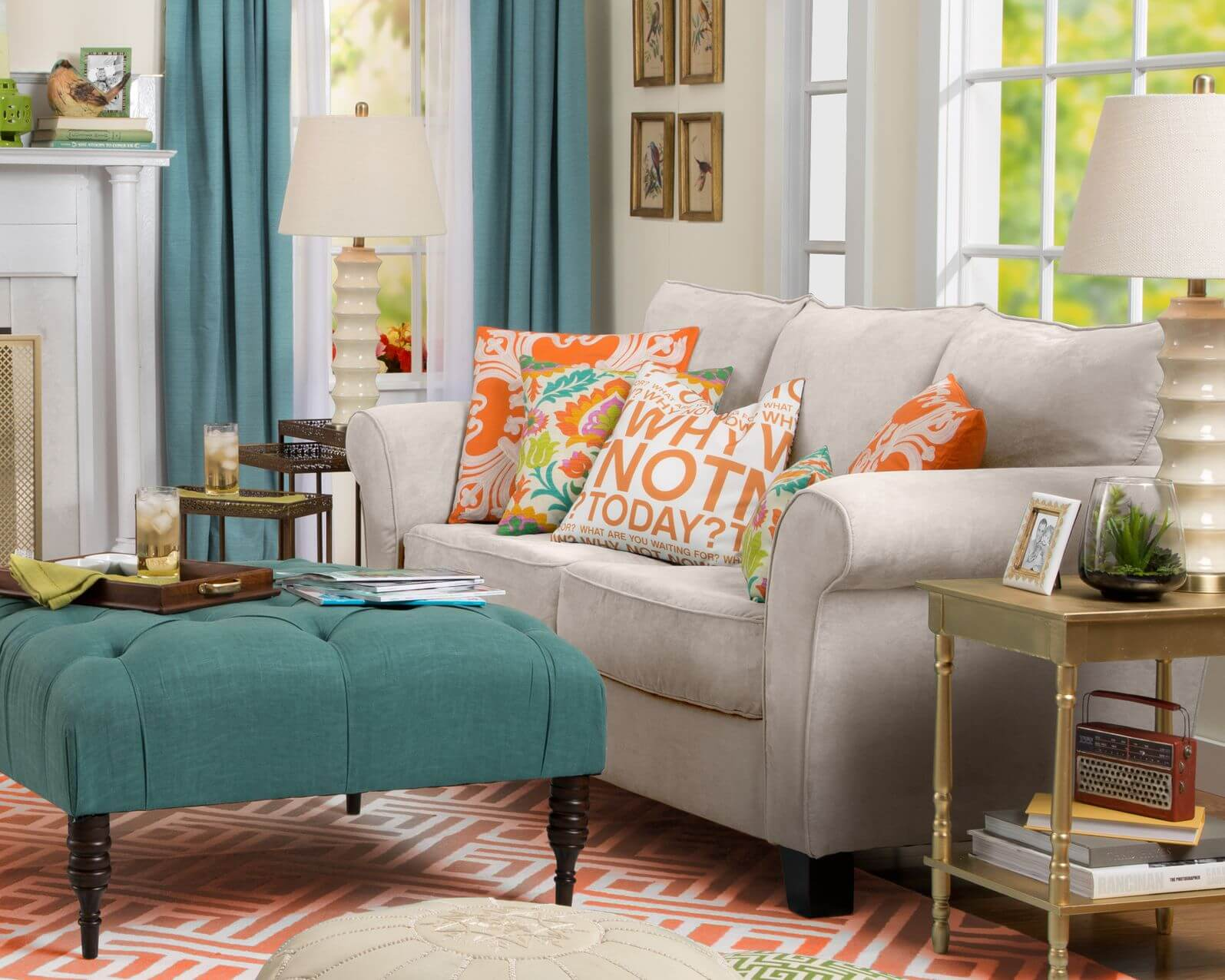Bright, contrasting color patterns throughout this living room, featuring neutral toned sofa next to teal button tufted fabric ottoman with dark wood arrow feet.