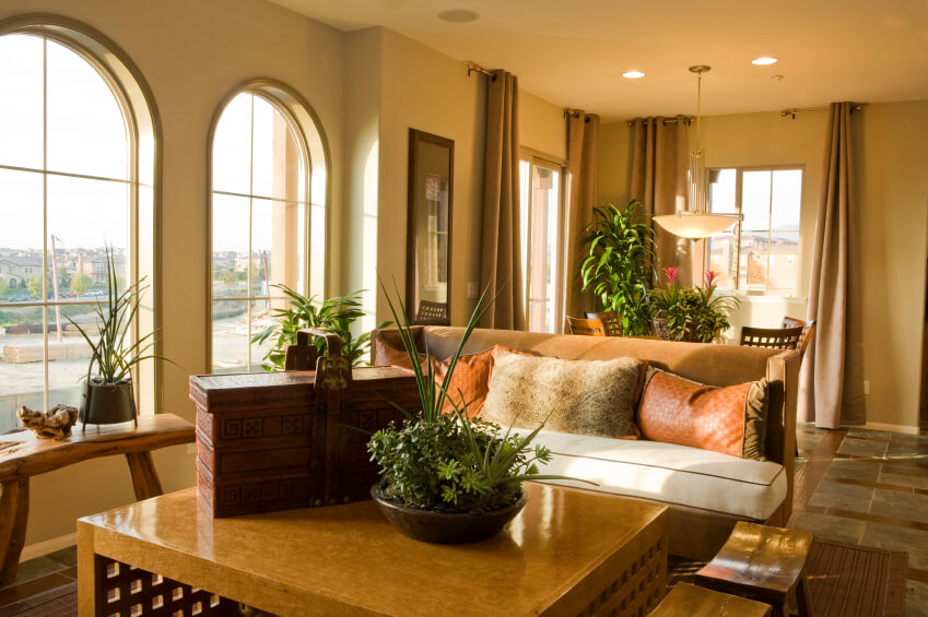 A Tile Living Room With A Natural Fiber Rug And Lovely Arched Windows. A  Carved Part 81