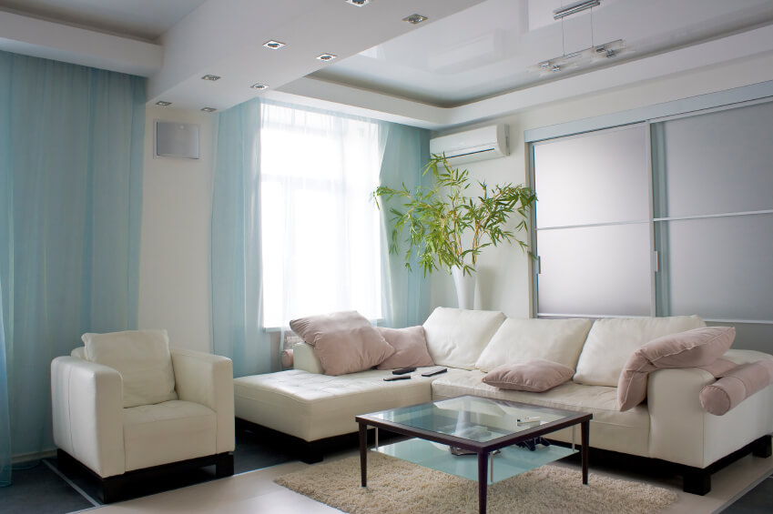 A Light And Bright Pastel Living Room With A Glass Top Coffee Table. Sheer Part 45