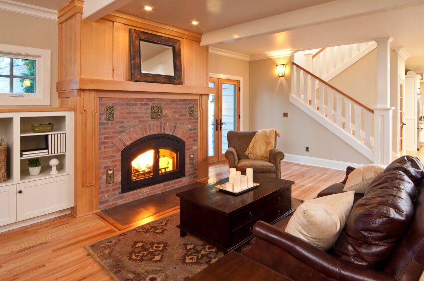 A Living Room Off Of The Foyer With A Large Wooden And Brick Mantle Around  The Part 88