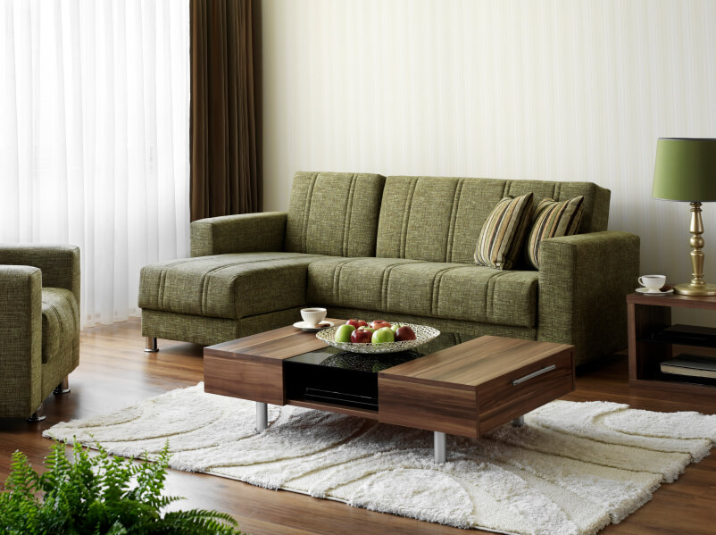 A Contemporary Living Room With Olive Green Furniture And Shaggy White Area Rug