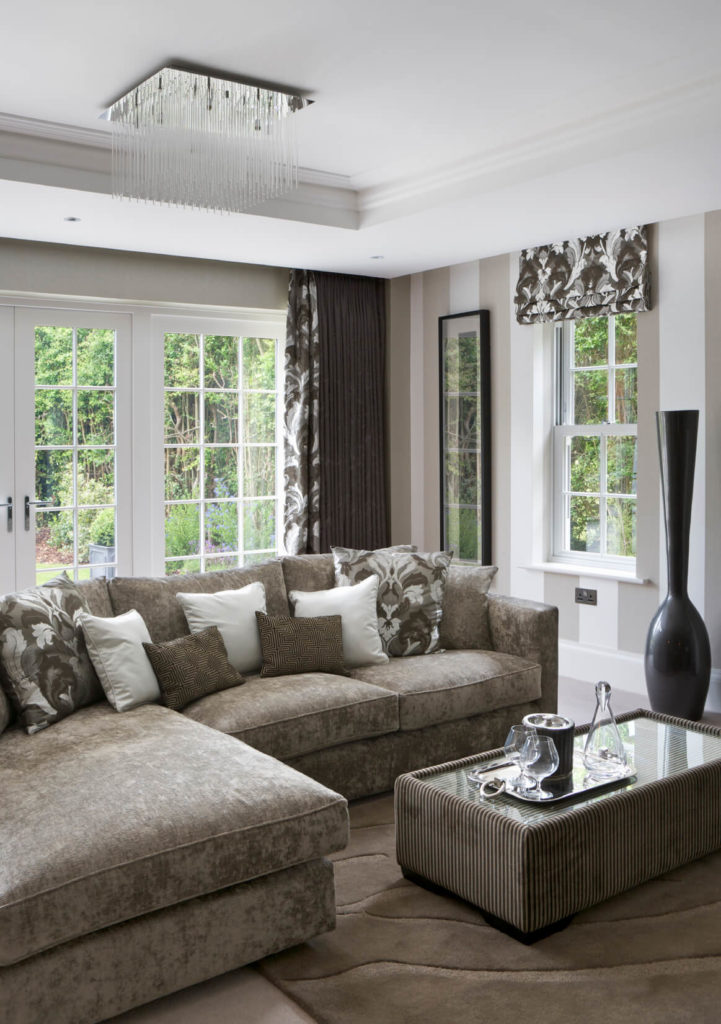 A Multi Textured Elegant Living Room. The Sofa Is In Soft Gray Suede,