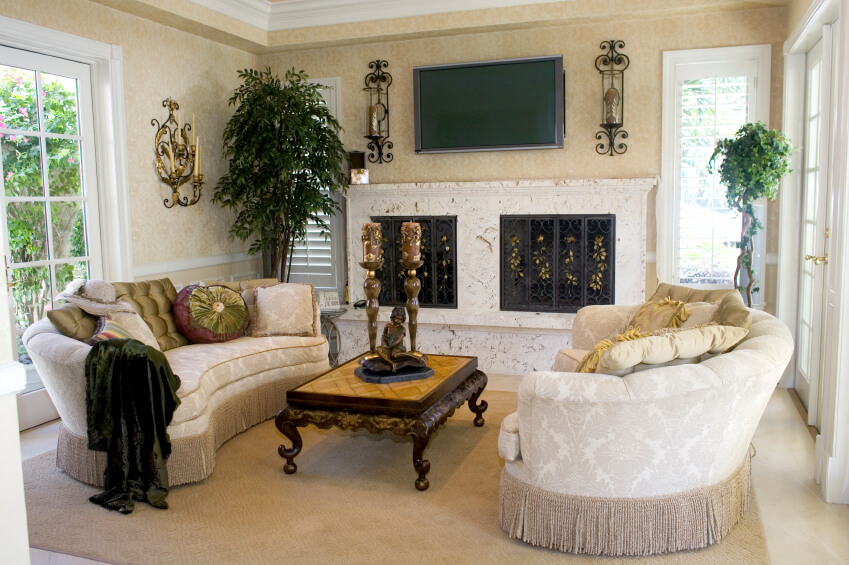 An Elegant Traditional Style Small Living Room With Matching Curved Sofas And Ornate Coffee