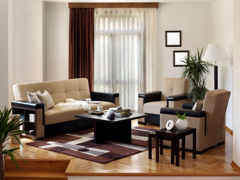 A Small Living Room Arrangement On A Wood Floor In A Chevron Pattern. The  Space