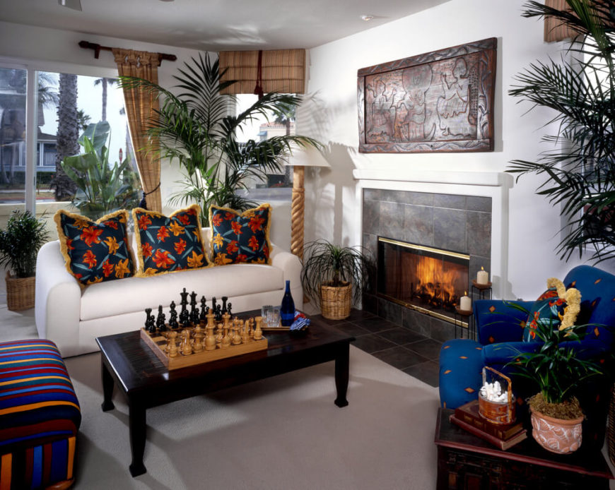 A Bold, Tropical Style Living Room With A Striped Armless Chair, A Blue Part 89