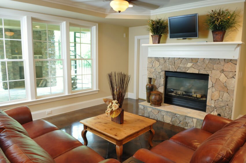 A Small Living Room With Tall Windows That Overlook The Covered Outdoor  Patiou0027s Huge Stone Fireplace Part 53