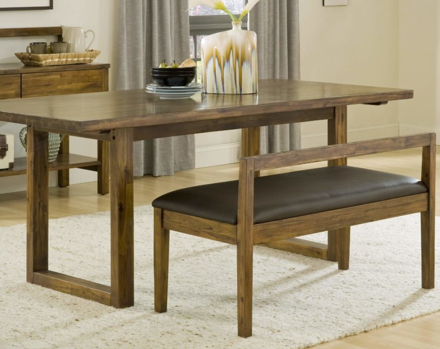 this rustic design wood dining table features a traditional structure with unadorned legs and surface