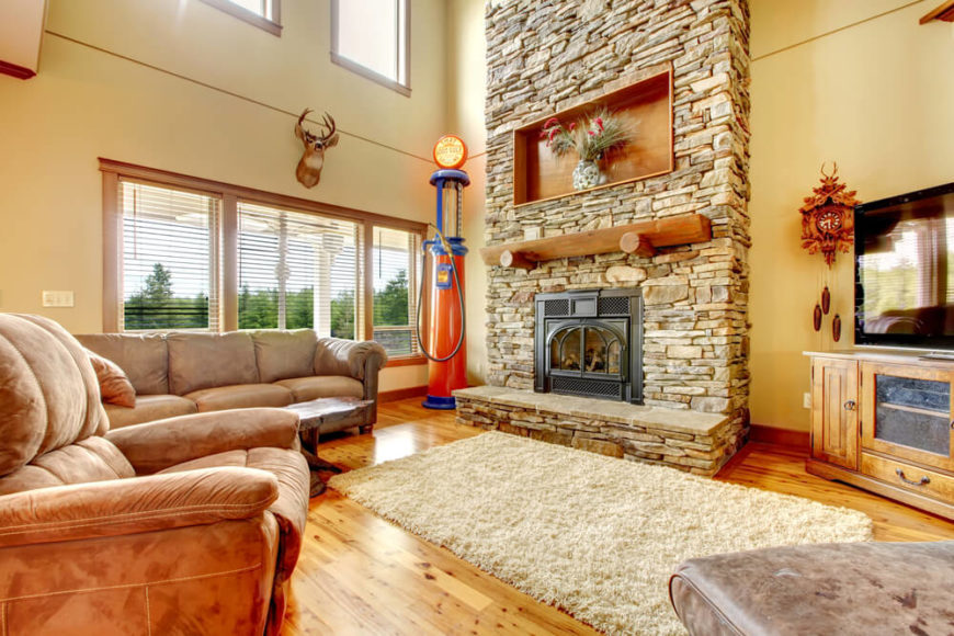 Beautiful An Eclectic Living Room With A Plush White Rug And An Enormous Stone  Fireplace That Extends Part 4