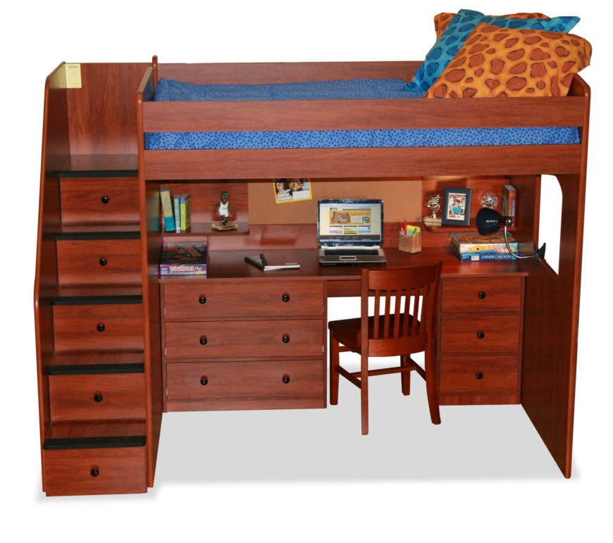 rich red wood tones inform this loft bed with a full size desk built in drawers on each side of the desk are by ones built into the staircase