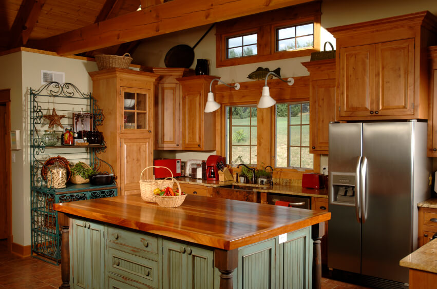 country style kitchen island with wood surface despite its more rare appearance hardwood countertops are one of the best options available for