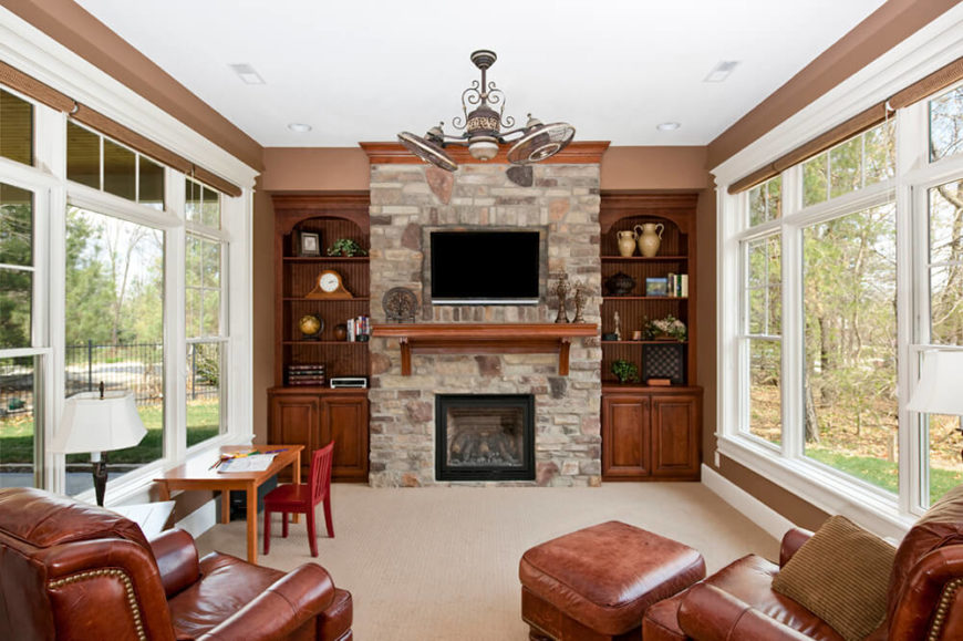 stone fireplace with tv. this marvelous stone fireplace has a wooden mantle just under the television for extra storage space with tv r